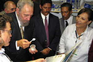 Fidel Castro samples U.S.-grown rice at the USA Rice booth during the 2002 International Trade Fair.