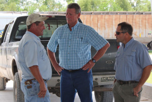 Mark Pousson, left, Wayne Hensgens with G&H Seed Co., Inc. in Crowley, La., and Horizon Ag general manager Tim Walker discuss the South Louisiana Rail Facility's capabilities.