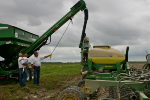 Christian and Saul, left, check on a custom planting job at producer Bud Baronet's rice farming operation in Acadia Parish. Custom planting is one way the Richards can diversify in an area where it is difficult to diversify by planting other crops.