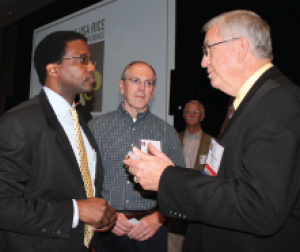 (From left to right) Reubén Ramos Arrieta, minister counselor in the economic and trade office of the embassy of the Republic of Cuba, chats with Bill Reed of Riceland Foods and Chuck Wilson, director of Arkansas Field Services for the USA Rice Foundation, at the recent Rice Outlook Conference in New Orleans.
