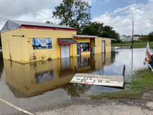 Floodwater surrounds a seafood store in Delcambre.